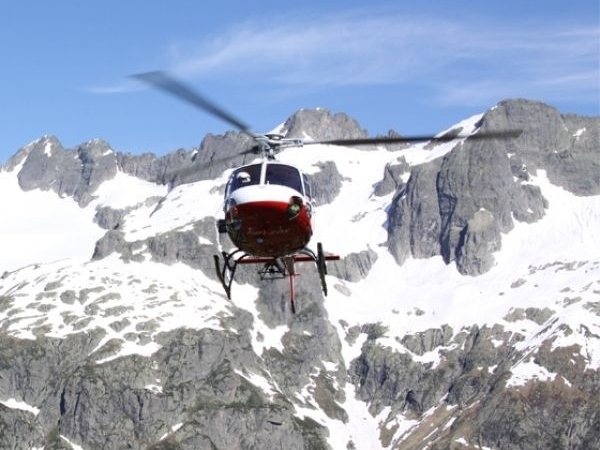 scenic flights organized by Ski Academy Andermatt in collaboration with Swiss Helicopter; panorama flight; Swiss pass roads; Urner Alps; Central Switzerland; breathtaking views;