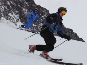telemark skier; private ski lesson in Andermatt; Ski Academy; go with a pro; learn to tele; telemark skiing; patient instructors; powder skiing;